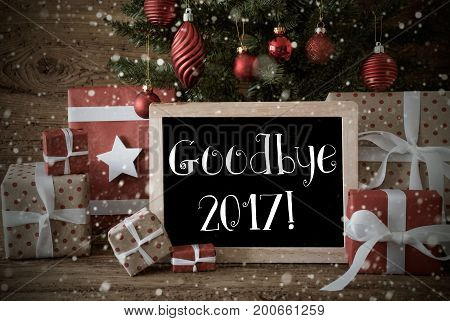 Nostalgic Christmas Card For Seasons Greetings. Christmas Tree With Balls And Snowflakes. Gifts Or Presents In Front Of Wooden Background. Chalkboard With English Text Goodbye 2017 For Happy New Year