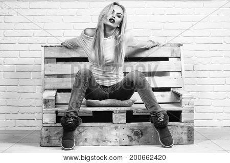 Girl Sits On Sofa