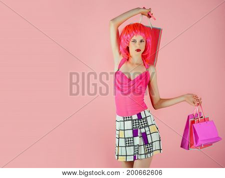 Girl Wearing Red Wig And Fashionable Clothes