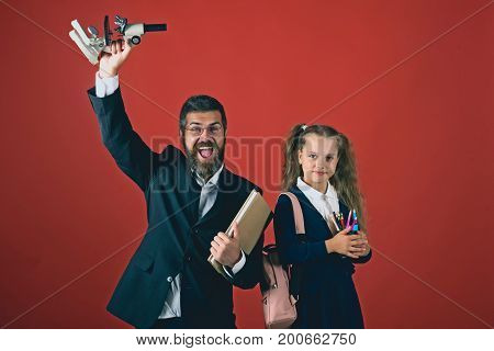 Teacher And Schoolgirl With Happy Faces On Terracotta Background
