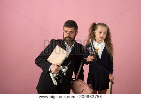 Kid And Tutor Hold Microscope, Book And Stationery