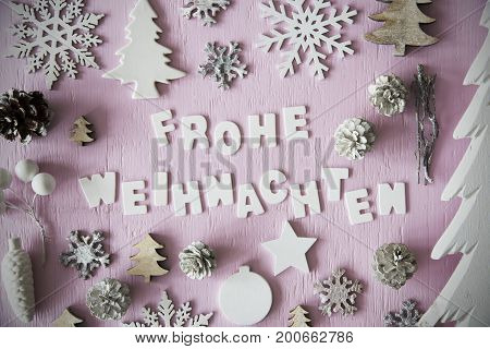 Letters Building German Word Frohe Weihnachten Means Merry Christmas. Many Christmas Decoration Like Tree, Star, Fir Cone And Snowflake. Flat Lay With Rose Background And Vintage Style And Frame