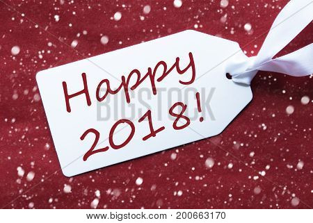 One White Label On A Red Textured Background. Tag With Ribbon And Snowflakes. English Text Happy 2018 For Happy New Year