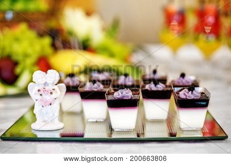 Sweet desserts with blueberry on glass. The concept of food restaurant cafe bar Candy holiday.