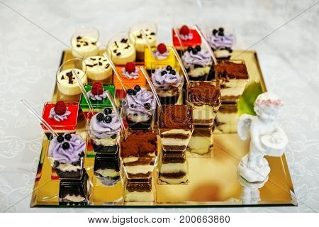 Assortment of various desserts on glass. The concept of food restaurant cafe bar Candy holiday.