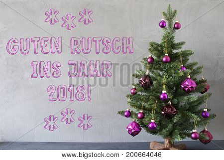 Christmas Tree With Purple Christmas Tree Balls. Card For Seasons Greetings. Gray Cement Or Concrete Wall For Urban, Modern Industrial Styl. German Text Guten Rutsch Ins Jahr 2018 Means Happy New Year