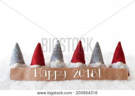 Label With English Text Happy 2018 For Happy New Year. Christmas Greeting Card With Gnomes. Isolated White Background With Snow.