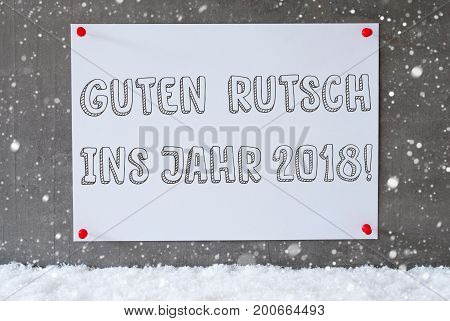 Label With German Text Guten Rutsch Ins Jahr 2018 Means Happy New Year 2018. Urban And Modern Cement Wall As Background On Snow With Snowflakes.