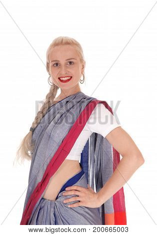 A beautiful blond woman standing in an east Indian outfit smiling with her braided hair isolated for white background