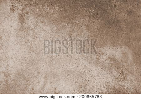 Blank grunge cement wall texture background brown colored