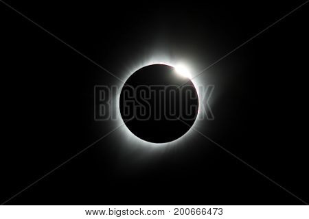 As the sun shines through the valleys of the moon the diamond ring is visible during the Total Eclipse USA 2017