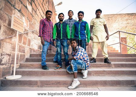 JODHPUR RAJASTHAN INDIA -MARCH 05 2016: Horizontal picture of Indians men posing at Mehrangarh Fort in Jodhpur the blue city of Rajasthan in India.
