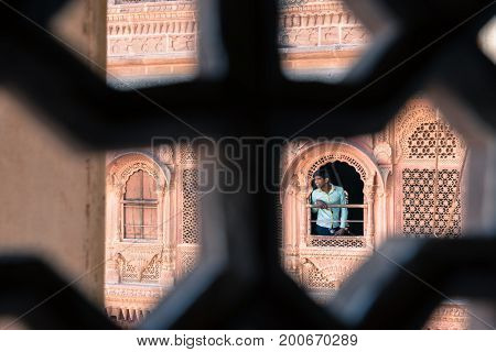 JODHPUR RAJASTHAN INDIA - MARCH 05 2016: Horizontal picture from behind the window of india men at Mehrangarh Fort in Jodhpur the blue city of Rajasthan in India.