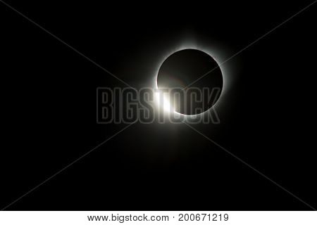 As the sun shines through the valleys of the moon a bright diamond ring is visible during the Total Eclipse USA 2017