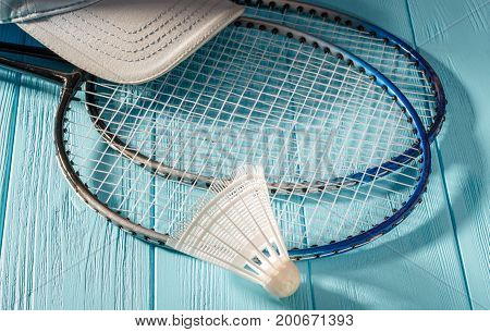Badminton racket and shuttlecock on a turquoise background