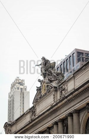 New York USA - September 26 2016: Close up image of the Glory of Commerce a sculptural group by Jules-Felix Coutan featuring Hercules Minerva and Mercury sits atop the entrance of Grand Central Terminal in Manhattan.