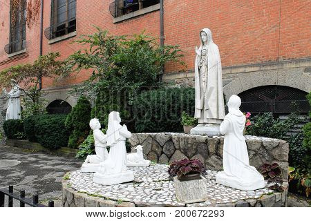 New York USA - September 27 2016: Holy statues outside the Church of St. Anthony of Padua a Catholic parish church in the Roman Catholic Archdiocese of New York located at 155 Sullivan Street
