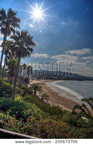 View of the sun over Main Beach, Laguna Beach, California right before the partial solar eclipse.