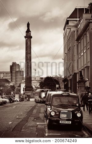 EDINBURGH, UK - OCT 8: City street view with traffic on October 8, 2013 in Edinburgh. As the capital city of Scotland, it is the largest financial centre after London in the UK.