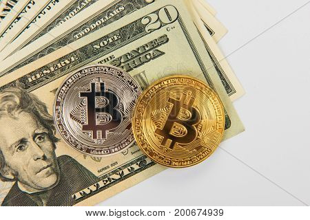 Bitcoin coin with dollars on the laptop background