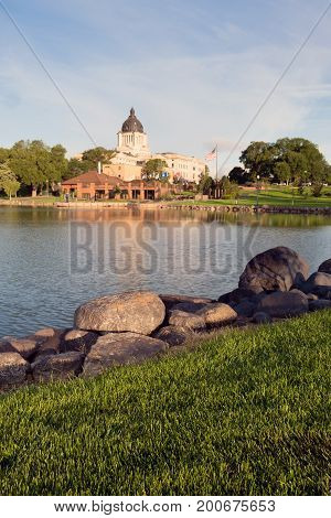 Water reflects the American Flag waving in front of the capitol dome in Pierre SD