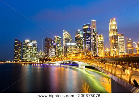 Abstract blurred background of Singapore downtown cityscape with modern skyline and  city skyscraper sunset at Marina Bay
