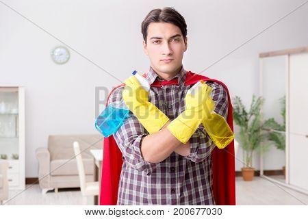 The super hero cleaner doing housework