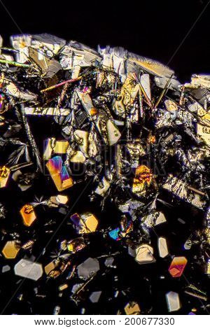 microscopic shot showing colorful microcrystals in polarised light