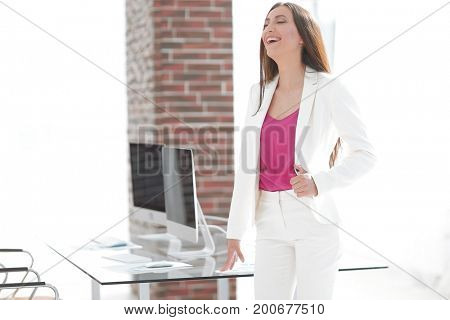 elegant business woman in a white business suit