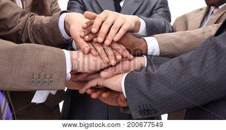 closeup - hands of businessmen stacked together