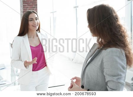 female Manager talking to a colleague