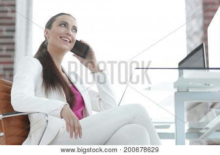 female employee talking on the smartphone