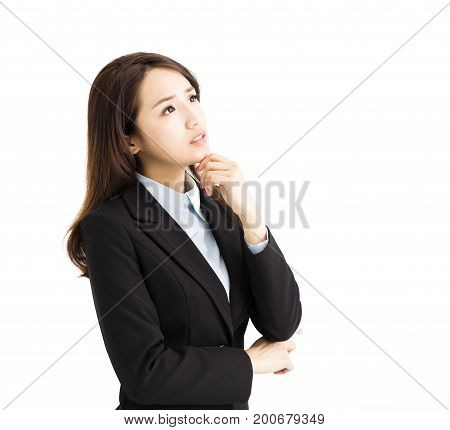 young business woman thinking and looking up