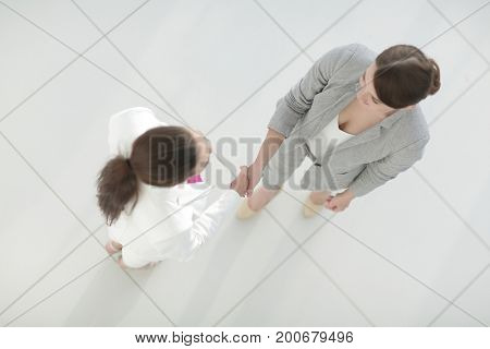 handshake of two business woman