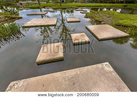 Maze Of Stepping Stones In Pond