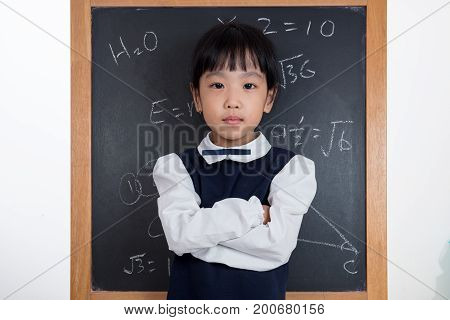Asian Chinese Little Girl Standing In Front Of Blackboard