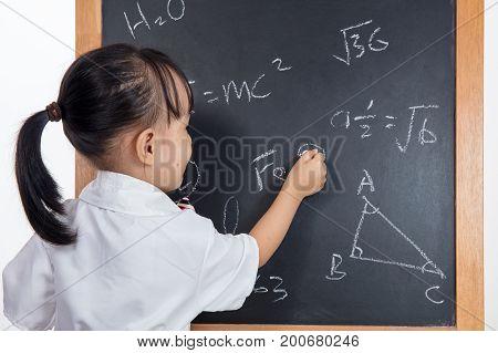 Asian Chinese Little Girl Writing On Blackboard
