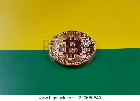 Symbolic coin bitcoin on yellow-green background. Current rate of bitcoin on exchange market.