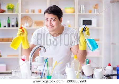 Man enjoying dish washing chores at home