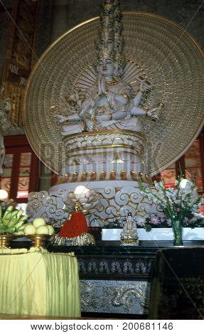 SINGAPORE / CIRCA 1990: A religious sculpture sits on an altar inside the historic Siong Lim Temple, also known as Lian Shan Shuang Lin Monastery, in Singapore..