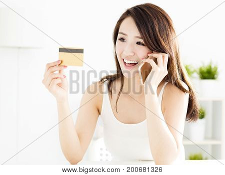 woman buying online with credit card and smart phone