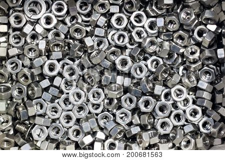 close up nut stainless steel for industrail background
