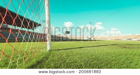 Green grass in soccer stadium vintage tone. soccer stadium. big soccer stadium. grass in soccer stadium. soccer stadium background.