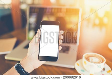 girl using smartphone in cafe. hand holding smartphone white screen. black color smartphone vintage tone. hand holding using mobile phone in coffee shop. hand using smartphone isolated. hand using black color smartphone. woman hand using smartphone. hand
