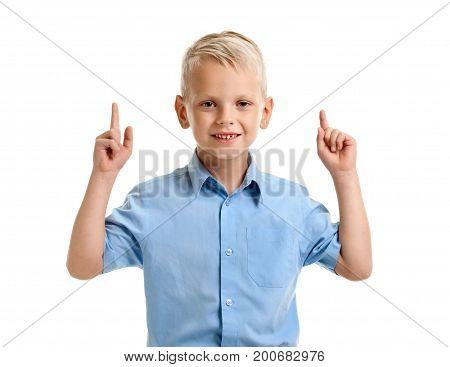Portrait of little genious boy with raised two fingers having an idea
