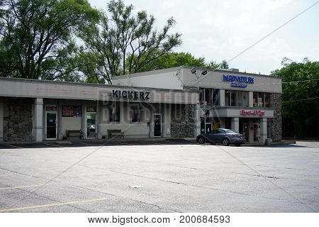 CREST HILL, ILLINOIS / UNITED STATES - JULY 19, 2017: One may drink beer at Kickerz, buy smoking accessories at the Headventure Smoke Shop and Gallery, women's clothing at Sheez All That, and skateboards at Jeric's Skateboard Shop, in the Key Plaza.