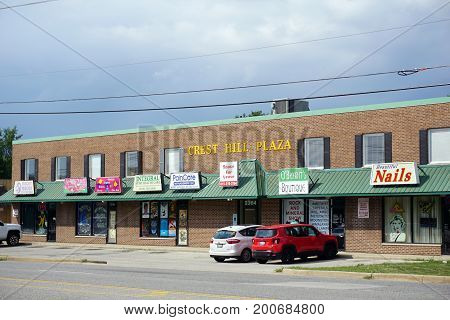 CREST HILL, ILLINOIS / UNITED STATES - JULY 19, 2017: The Crest Hill Plaza houses Rocky Mudds, Integral Home Health Care, Pain Care Management, O'Bryant's Boutique, and Beautiful Nails.