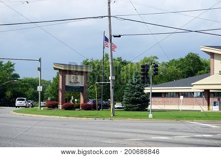 CREST HILL, ILLINOIS / UNITED STATES - JULY 19, 2017: The Numark Credit Union offers banking services, at the corner of Caton Farm and Plainfield Roads.