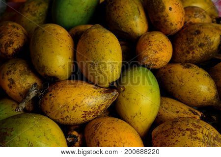 Stack Of Yellow Green Egg Fruits  At The Market