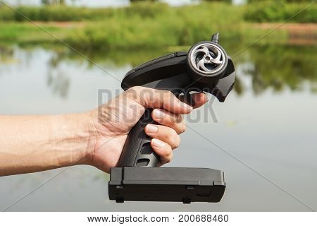 close up man hold speed boat remote control for playing
